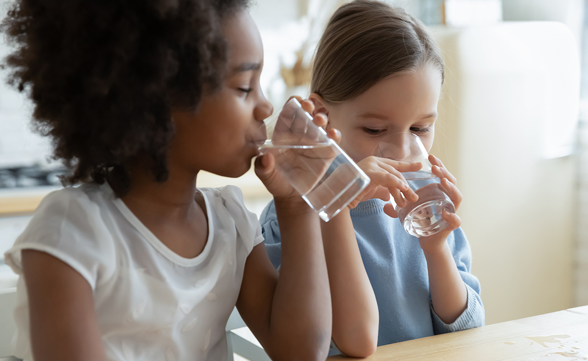 children drinking clean healthy water in child care facility