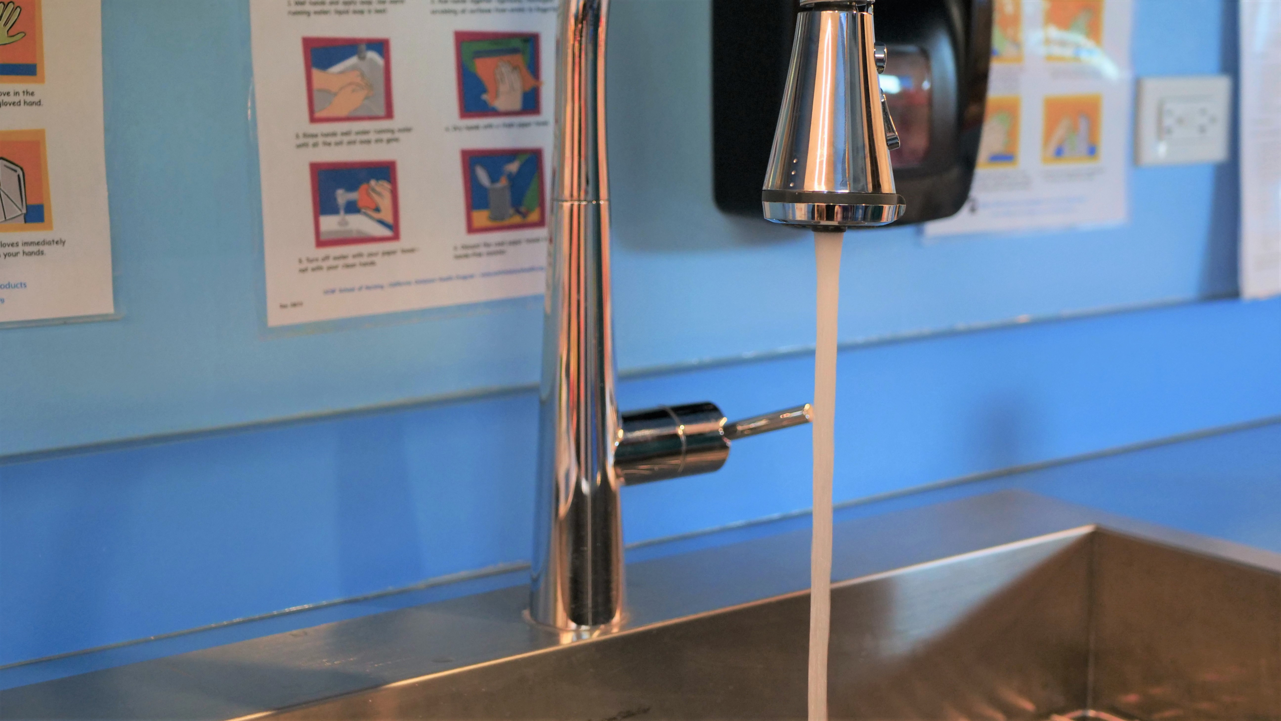 child care provider running water fixture